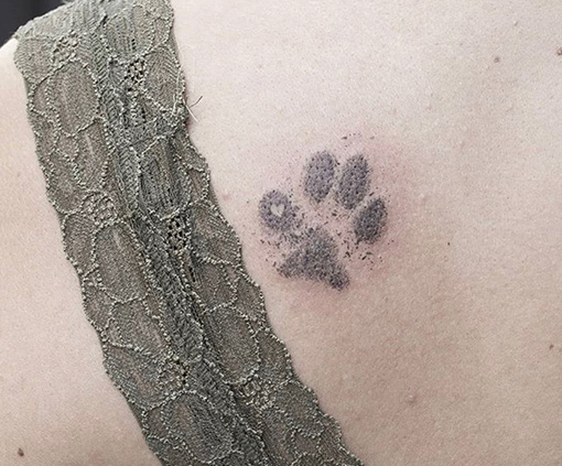 tatuajes finos | huella animal
