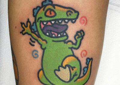 cartoon tattoo de dinosaurio